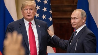 President Donald Trump and Russian President Vladimir Putin shake hands during a joint press conference after their summit Monday in Helsinki, Finland.