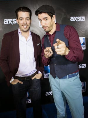 """The stars of reality TV show """"Property Brothers"""" strike a pose on the red carpet of DIRECTV's Super Saturday Party at Pendergast Family Farms on Saturday, January 31, 2015."""