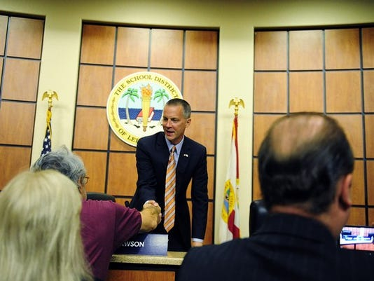 Corey Perrine/Staff Curt Clawson greets a supporter after a Congressional District 19 Republican candidate debate Wednesday, April 9, 2014 at the Lee County School District Headquarters in Fort Myers. State Senator Lizbeth Benacquisto, Curt Clawson, Michael Dreikorn, and Dr. Paige Kreegel were present for the two hour televised moderated debate.