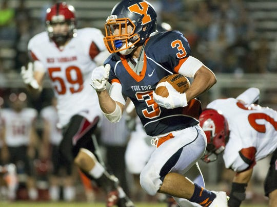 William Penn's Bryshon Sweeney breaks into the J.P. McCaskey secondary last year at Small Field. With a 10-percent rule, the Bearcats would drop from 4A to 3A in a four classification format. (FILE -- GAMETIMEPA.COM)