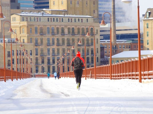Fearless runners cross the Stone Arch Bridge in all seasons