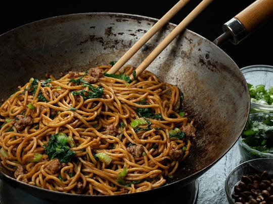 Noodles are tossed in an oil flavored with Sichuan peppercorns, then finished with peanuts, green onions, cilantro, garlic and more peppercorns, this time ground into a powder.