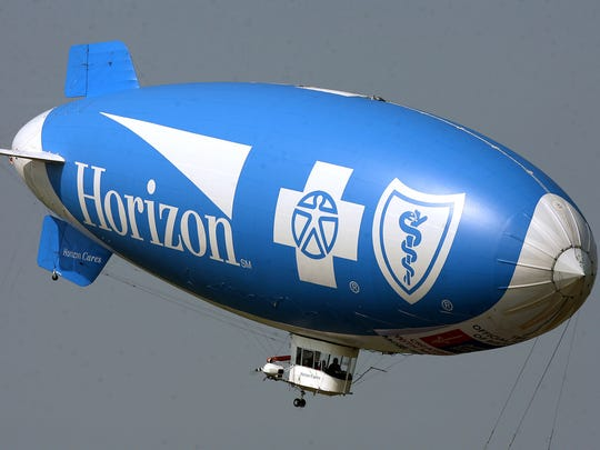Horizon Blue Cross Blue Shield of New Jersey said Thursday it would expand what it calls patient-centered-medical homes, a new insurance model that emphasizes preventive services in hopes that it will cut down on more expensive care in the long-run. The Horizon Blue Cross Blue Shield blimp flies near Solberg Airport in Readington in this 2009 file photo.