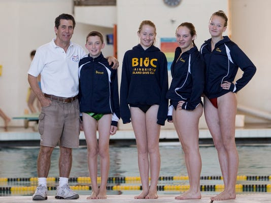 Bainbridge Island Dive Club coach Chris Miller, left, and divers Duncan Platz, Jackie Hellmers, Cammy Rouser and Zora Opalka, competed at the AAU Northwest Holiday Dive Meet in Beaverton, Ore.