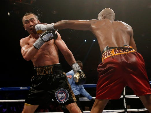 Bernard Hopkins  (red trunks) and Beibut Shumenov  (black trunks) in action during their bout at DC Armory.