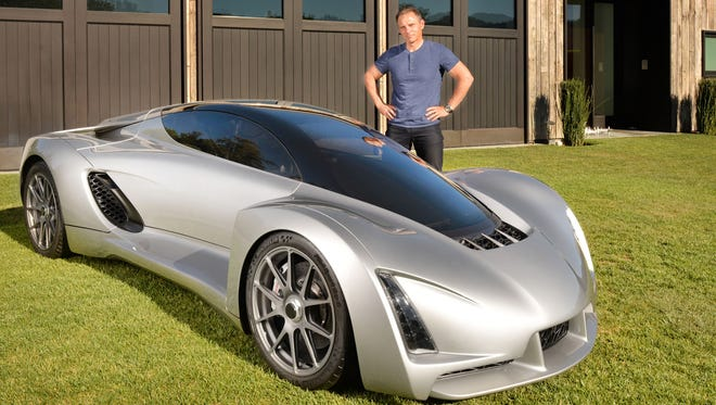 Kevin Czinger, CEO of Divergent Microfactories, shows off the Blade 3D-printed supercar