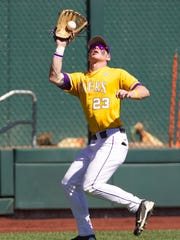 LSU left-fielder Jake Fraley catches a fly ball in the 2015 College World Series.