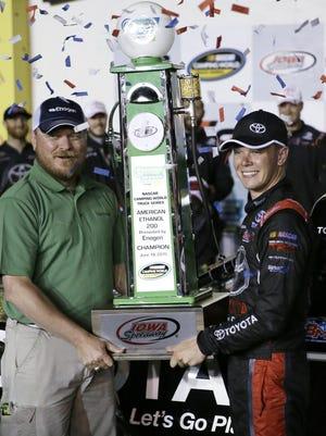 Bryon's Erik Jones receives the trophy after winning the Trucks race Friday in Newton, Iowa.