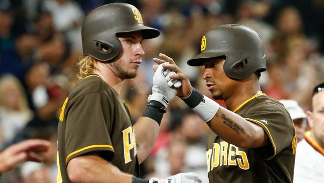San Diego Padres' Christian Bethancourt, right, is greeted by Travis Jankowski after scoring against the Arizona Diamondbacks in the seventh inning of a baseball game Friday, Aug. 19, 2016, in San Diego.