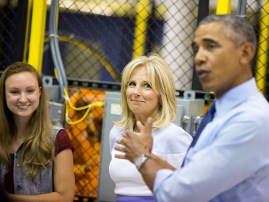 President Barack Obama, accompanied by Jill Biden (second from right) tours Michigan Technical Education Center at Macomb Community College in Warren, Mich., on Wednesday.