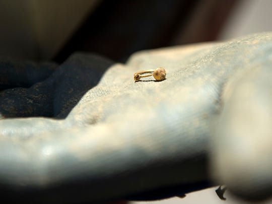 An earring, discovered in the exhumation process, was