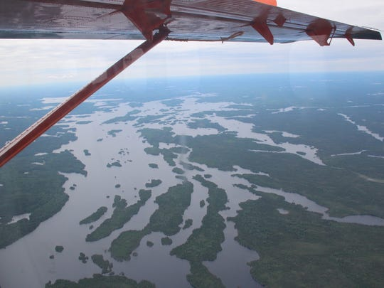 A matrix of lakes, bogs and rivers is seen from a float plane over the boreal forest of northwestern Ontario.