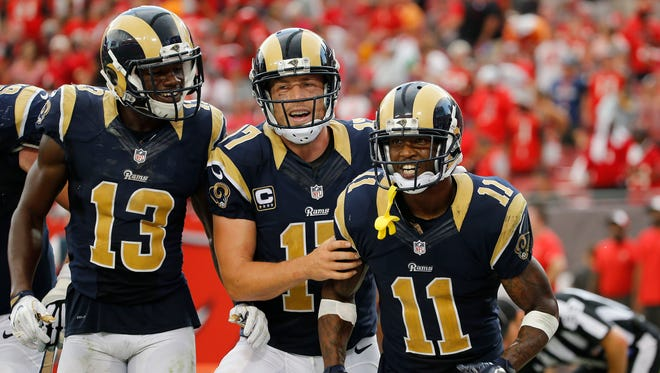 Sep 25, 2016; Tampa, FL, USA; Los Angeles Rams wide receiver Tavon Austin (11) is congratulated by  quarterback Case Keenum (17) and wide receiver Mike Thomas (13) after he scored a touchdown against the Tampa Bay Buccaneers during the second half at Raymond James Stadium.