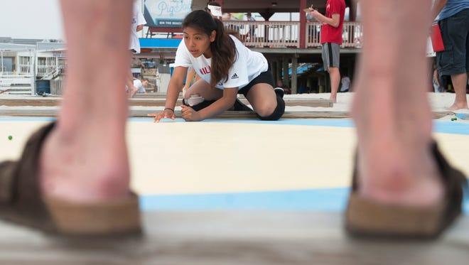 Lisbeth Garcia, 14 of Wildwood, competes in the National Marbles Tournament in Wildwood on Monday, June 18, 2018.