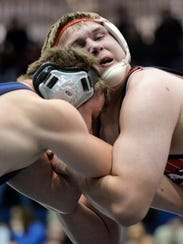 Dallastown's William Anderson, left, wrestles Bermudian
