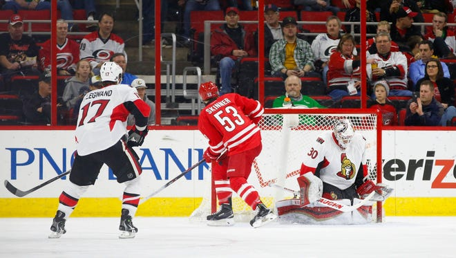 Ottawa Senators goalie Andrew Hammond (30) stops the shot by the Carolina Hurricanes forward Jeff Skinner (53) during the 1st period at PNC Arena.