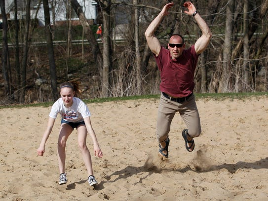 Hope, 12 and her father Garrett Stangel, demonstrate