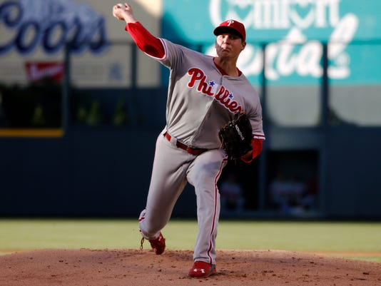 Philadelphia Phillies starting pitcher Jerad Eickhoff delivers to Colorado Rockies' Carlos Gonzalez in the first inning of a baseball game Saturday, July 9, 2016, in Denver. (AP Photo/David Zalubowski)