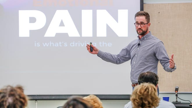 Austin Eubanks, a survivor of the Columbine school shooting speaks about addiction resulting from trauma during the 11th Annual Susan Li Conference at Hope Academy Recovery High School in Indianapolis on Thursday, July 19, 2018. The Susan Li Conference is put on annually by Fairbanks.