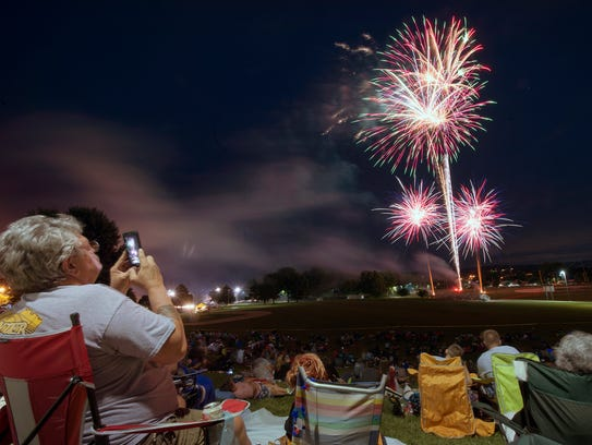 Dennis Adkins records fireworks on a smartphone in