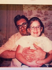 Nicole Millard, as a child, with her dad.