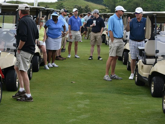 Nearly 100 players lined up for the shotgun start of
