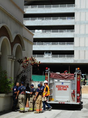 Guam Fire Department personnel respond to a report of an injured construction worker at the Dusit Thani Guam construction site in Tumon on Oct. 18. The worker later died from a head injury.