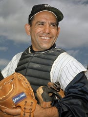 """New York Yankee catcher Yogi Berra poses at spring training in Florida in this undated file photo. The Hall of Fame catcher renowned as much for his lovable, linguistically dizzying """"Yogi-isms"""" as his unmatched 10 World Series championships with the New York Yankees, died Tuesday. He was 90."""