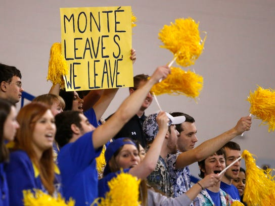 Fans show support for head coach Monte Ross, who has