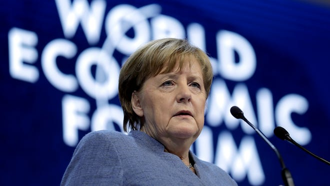 German Chancellor Angela Merkel looks to the audience during her special address as part of the annual meeting of the World Economic Forum in Davos, Switzerland.