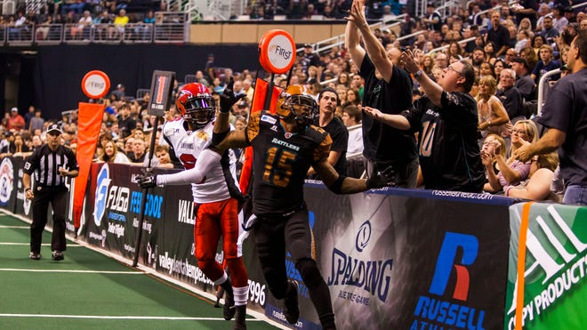 Fans attempt to catch a pass intended for the Rattlers' Kerry Reed (15) during the Jacksonville Sharks and Rattlers game at US Airways Center.