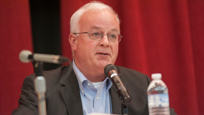 Mark Behnke speaks at the City Commission candidate forum in 2013.