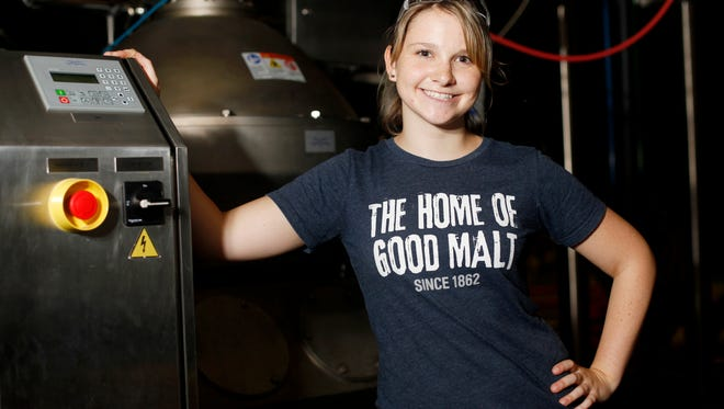 Katie Smith, a cellarman at Highland Brewing Company, stands at the centrifuge September 28, 2016.