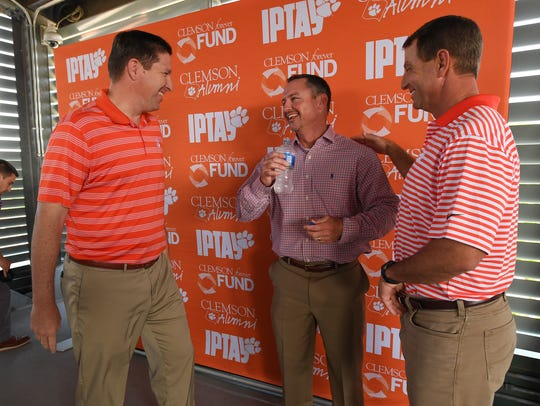 Clemson coaches, from left, Brad Brownell, Monte Lee,