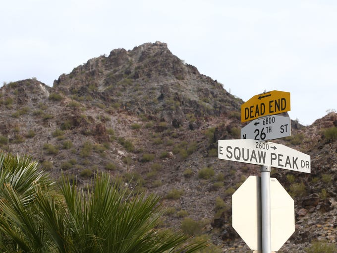 The Squaw Peak Drive sign is seen with Piestewa Peak