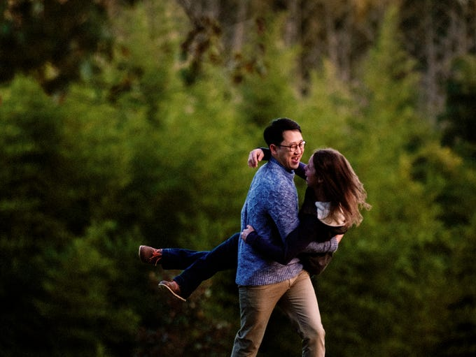 Sung Lee, of Atlanta, catches his fiancŽ Cameron King,