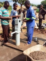 A well is being constructed in Malawi after a group