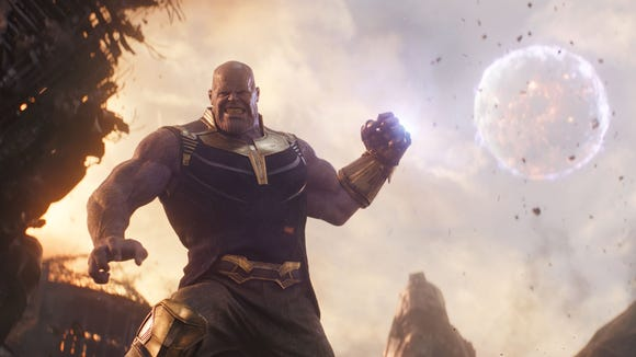Thanos (Josh Brolin) smashes superheroes and