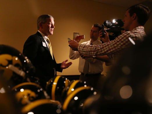 Iowa Football Coach Kirk Ferentz talks to members of