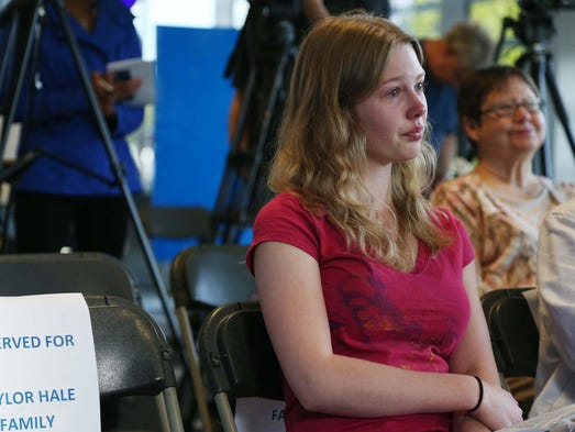 Taylor Hale, 18 of Waukee listens to her mother Stacy