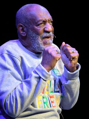 """Bill Cosby performed to a welcoming Denver audience, despite a protest by some 100 people chanting """"Rape is not a joke!"""" and """"No means no!"""" outside the theater."""
