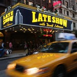 """Traffic moves down Broadway, past the Ed Sullivan Theater where the """"Late Show with David Letterman"""" is taped."""