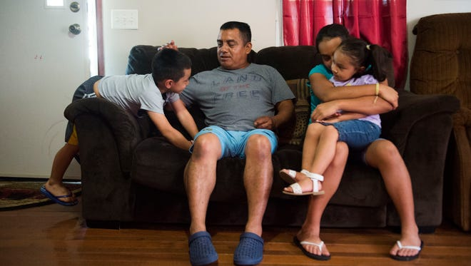 At center Alberto Librado, sits with his children from left, Abdiel, 5, Sheryln, 11, and Jeylani, 3, in their White Pine, Tenn. home July 3, 2018. Alberto was detained by U.S. Immigration and Customs Enforcement agents when they raided the Southeastern Provision meat-packing plant where he worked outside Bean Station in April.