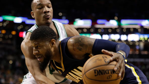 Indiana Pacers forward Paul George (13) works the ball
