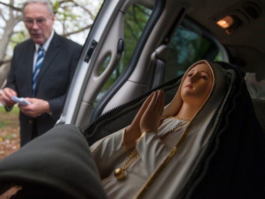 Carl Malburg of Muster, IN, a custodian/director of the International Pilgrim Virgin Statue Foundation, Inc. prepares to unload the International Pilgrim Virgin Statue of Our Lady of Fatima from his van and into St. Joan of Arc Church in Camden on Friday. 05.01.15