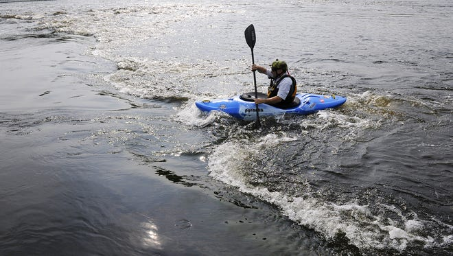 Ivan Bartha maneuvers his kayak near a section of rapids on the Mississippi River Wednesday, Aug. 6, 2014.