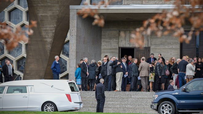 People gather on the steps of the St. John's Abbey church following a funeral service Wednesday, Nov. 2, for Bobby Vee in Collegeville.