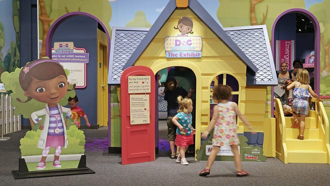 Children explore a new interactive Doc McStuffins exhibit based on the Disney television show, at the Children's Museum of Indianapolis, Sunday, August 7, 2016. The exhibit runs through January 22, 2017.
