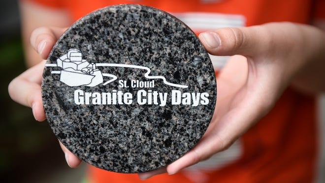 Declan Frantesl holds the Granite City Days medallion in June 2017 at River Bluffs Regional Park in St. Cloud.