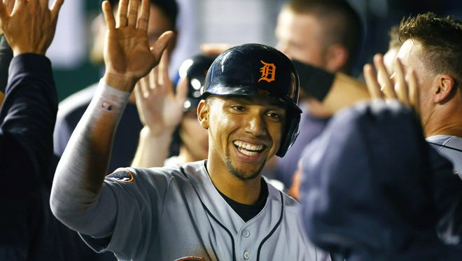 Sep 28, 2017; Kansas City, MO, USA; Tigers' Dixon Machado is congratulated after scoring against the Royals in the fifth inning at Kauffman Stadium.